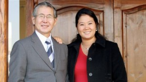 Peru's former President Alberto Fujimori, left, and his daughter Keiko Sofia, pose for photographers at his home in the neighborhood of Chicureo in Santiago, Monday, July 9, 2007. The Chilean judge who will decide whether Alberto Fujimori will be extradited to Peru, said Tuesday he would issue his verdict within days. (AP Photo/Geraldo Caso Bizama)