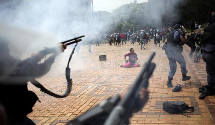 A student is seen during clashes with South African police at Johannesburg's University of the Witwatersrand, South Africa. REUTERS/Siphiwe Sibeko