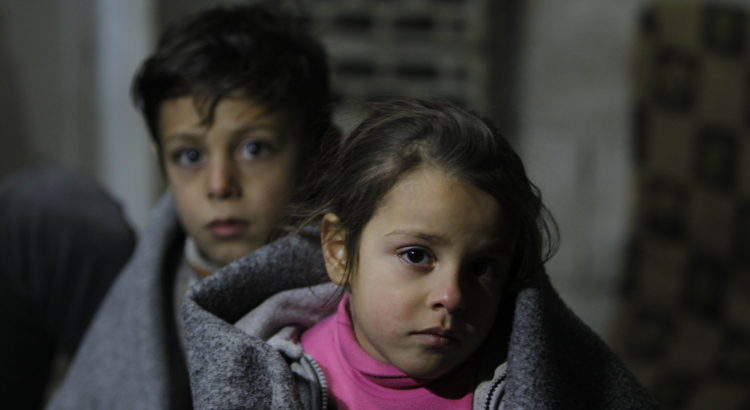 On 5 January, Ghinwa, 7, and her brother Alaa, 11, at Al-Khalidia Al-Khamisa informal settlement in Homs. As their house in this unfinished building remains in a dire condition and many repairs are needed to make it suitable for winter, Ghinwa and Alaa are trying to get warm with blankets.   UNICEF is targeting one million children throughout the country with winter supplies during the 2015/2016 winter season.   So far, winter clothing kits and blankets have reached 95,000 children while delivery and distribution is ongoing for 545,000 children.  In addition, 2,000 heaters are currently being installed in classrooms benefiting 80,000 children.