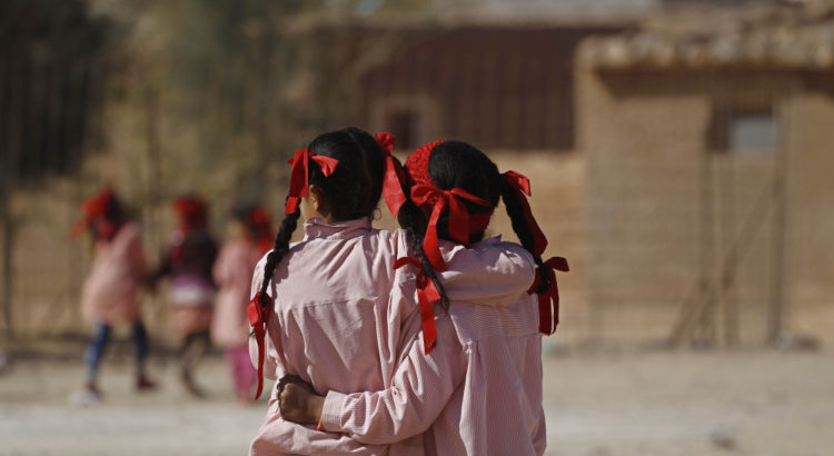 Indigenous Sahrawi girls hug each other beside their school in a refugee camp of Boudjdour in Tindouf, southern Algeria March 3, 2016. UN Secretary General Ban Ki-moon is scheduled to visit the Sahrawi refugees in south-west Algeria's Tindouf region. REUTERS/Zohra Bensemra - RTS95NH