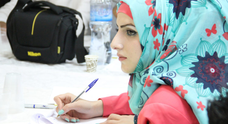 A young Palestinian woman learns about the finer points of democratic governance at a UNDP supported training session.  Photo: UNDP/PAPP and Sharek Youth Forum